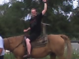 On a horse.